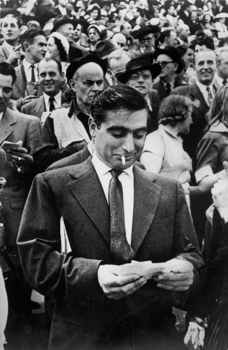 1953. Longchamp, Paris, France. Racecourse. Photographer Robert Capa by Henri Cartier-Bresson