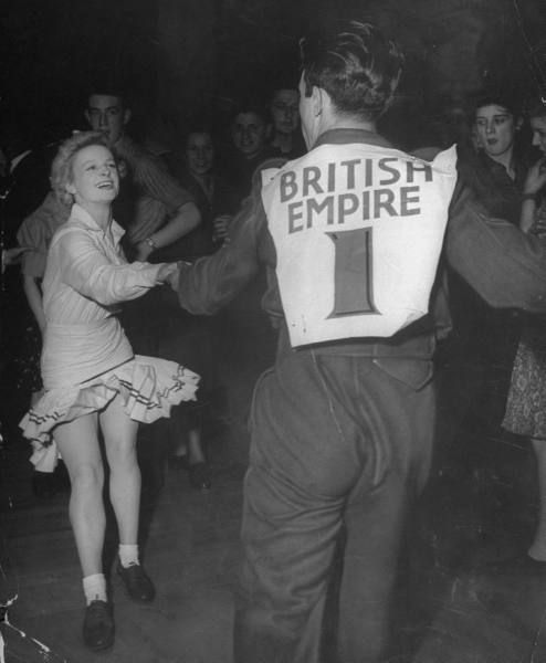 Jitterbug dancing conest in a blackout in London's West End during World War II.