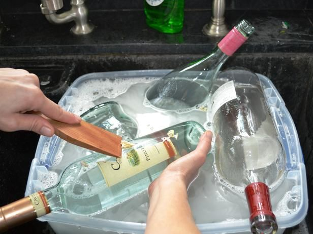 How to Turn Old Bottles into Picture Frames: Clean the bottles well with soap and water. If the adhesive does not come off, try using a product like Goof Off or Goo Gone. Let bottles dry completely, inside and out. (Sometimes a paper towel stuck in the top helps dry inside out.) From DIYnetwork.com