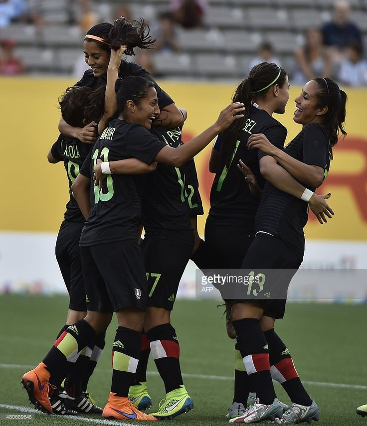 July 14 - Football - Women - First Round. Mexico vs Argentina. Players of Mexico celebrate after teammate Teresa Noyola (L) scored against Argentina during a women's first round group A football match of the Pan American Games in Hamilton, Canada, on July 14, 2015. AFP PHOTO / OMAR TORRES