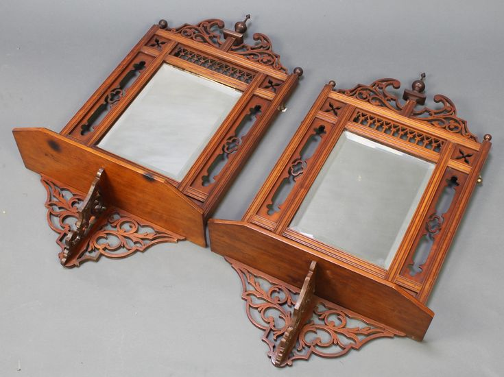 "Lot 963, A pair of Victorian rectangular bevelled plate mirrors contained in pierced walnut frames incorporating a shelf 32""h x 16""w x 7""d est £50-75"
