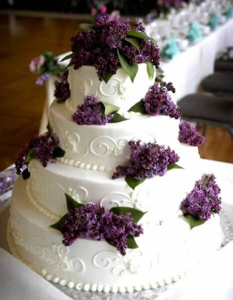 You could get a white cake, simply decorated, and then we could DIY some lilacs on top. Simple, and pretty :)