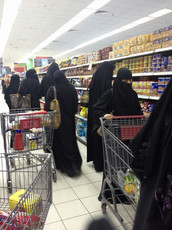 Here in the west, our media often portrays women in niqab as oppressed and shut away. But these women are shopping for groceries the same as any of us, are not a seperate species to be judgemental about, and they have an allure all their own that we in america will likely never possess