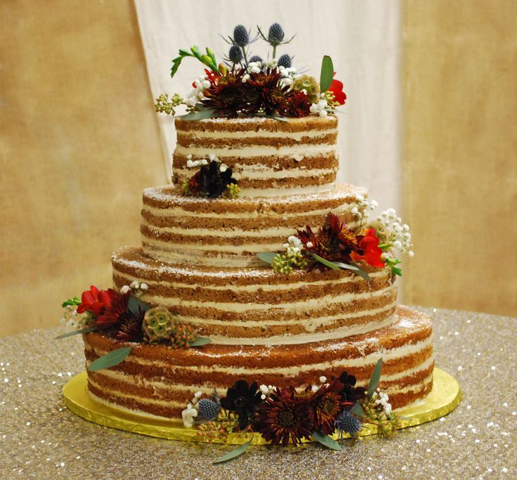 Naked Wedding Cake ~ oval shaped with layers torted. Spice with Maple Buttercream. Wildflowers and thistles combine to make the perfect Fall / Autumn rustic look! toptierweddingcakes.dotphoto.com Medford, Oregon