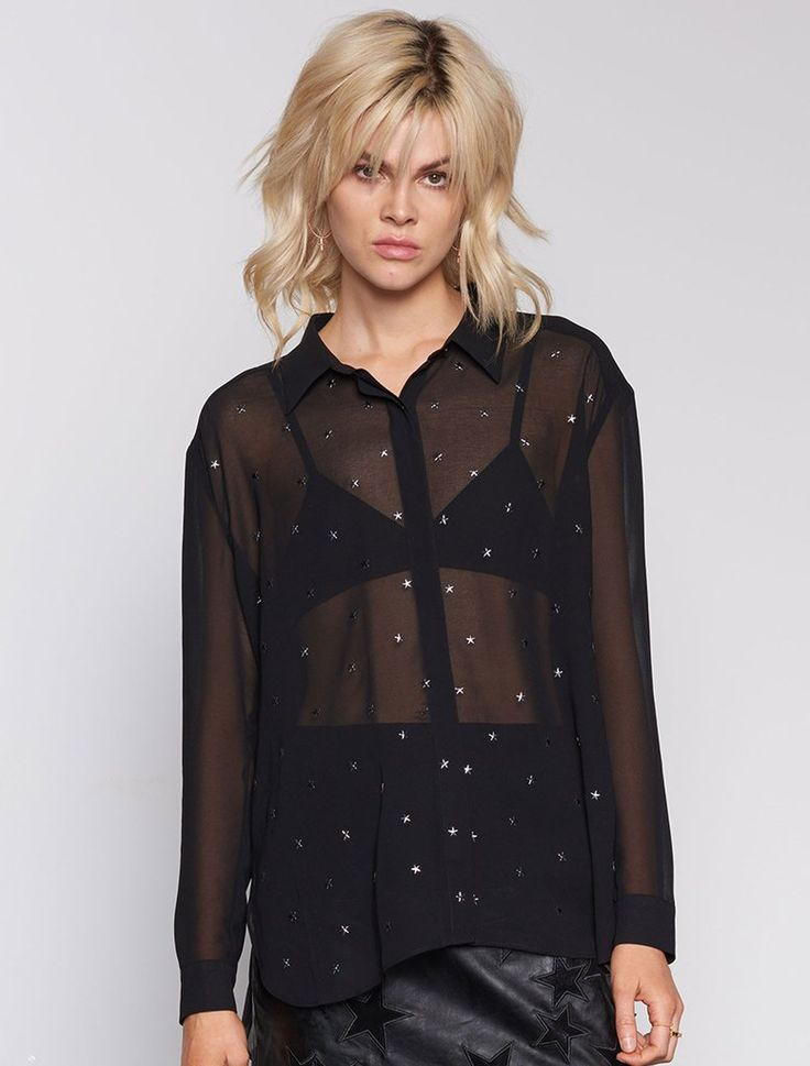 ISLA NEBULA BLOUSE. The must buy shirt of the season, this sheer star embellished button up shirt has a statement pleated back and dip back hem. Available www.islalabel.com