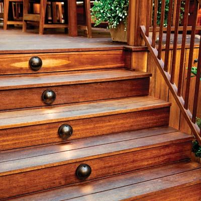 Discreet domed lights on the risers of this outdoor deck illuminate the steps below. | Photo: Mark Lohman | thisoldhouse.com