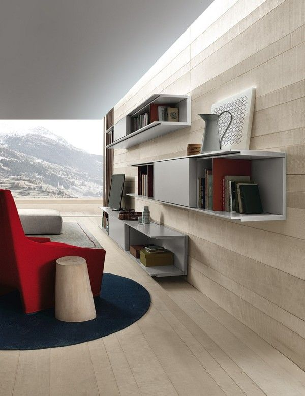 Sleek Wall Mounted Shelves And Closed Cabinets Make Up The Living Room Wall Unit