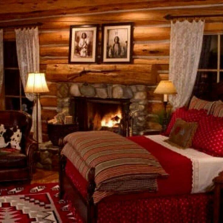 Super Cozy Log Cabin Bedroom With Stone Fireplace, Aztec Rug, Leather  Wingback Chair, And Cowhide Pillow Xxx