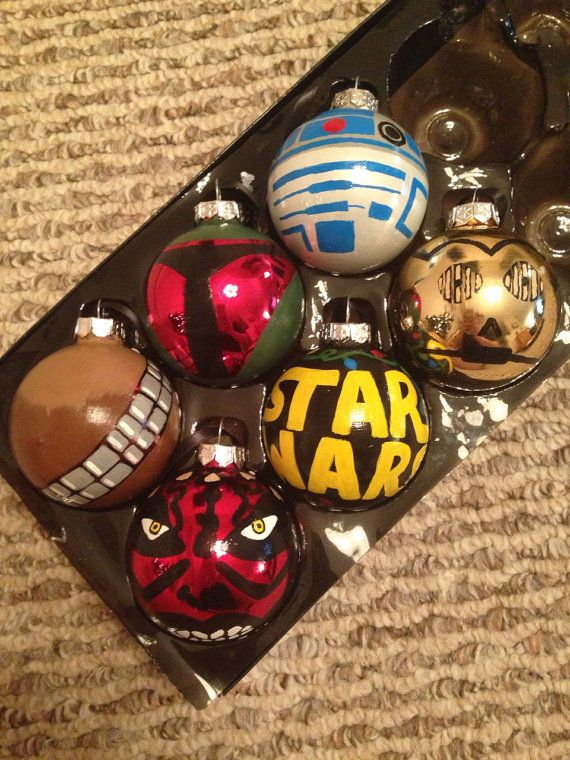 These glass ornaments are 3 inches by 3 inches. This set includes R2D2, C3PO, Boba Fett, the Star Wars logo with Christmas lights, Chewbacca, and