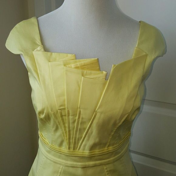 Karen Millen structured cocktail dress BNWT Pale yellow Karen Millen dress - UK size 10, US size 6, EU 38. Very structured with geometric folds at the neck, shoulders, back, and back of skirt. Purchased at the London Karen Millen store years ago and have never worn. Finally time to let her go to a great home where her beauty can be shown off. Karen Millen Dresses