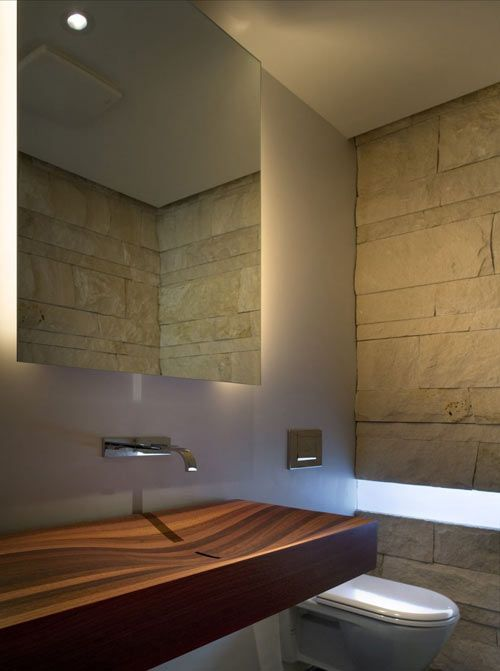 Sexy sink....floating mirror...window slot...stone wall. love. Syncline House by Arch11.