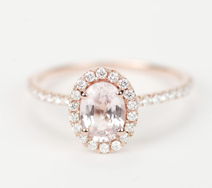 My lovely engagement ring :) Peach Pink Champagne Oval Sapphire Diamond Halo Engagement Ring 14K Rose Gold. $1,170.00