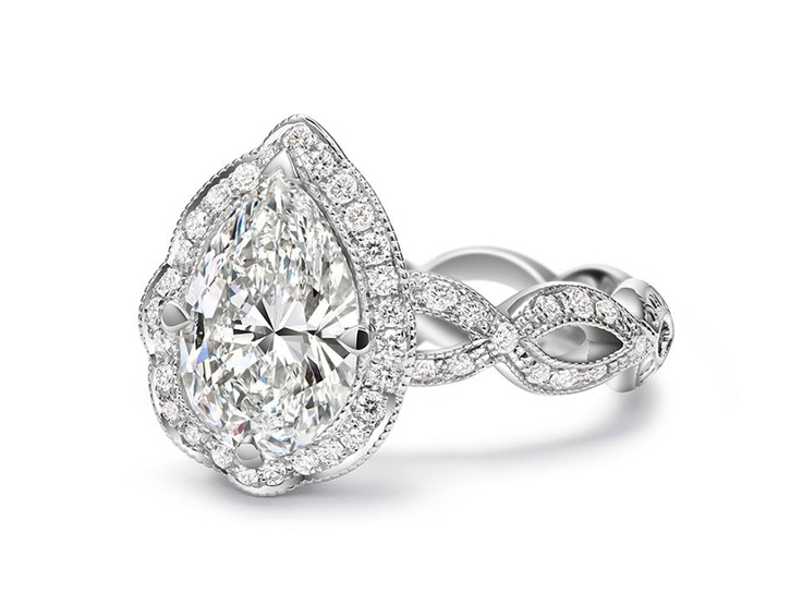 Gorgeous teardrop halo engagement ring from Calvin s I do someday