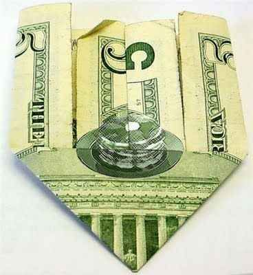 A stack of pancakes is hidden in the $5 bill.