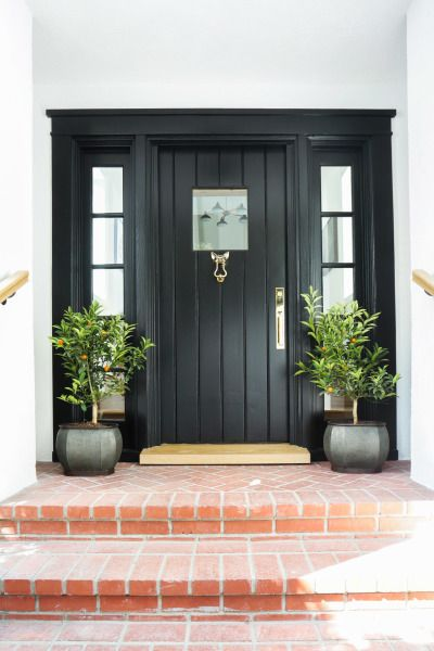 Behr black smoke can give a home a classic look: http://www.stylemepretty.com/living/2016/08/17/20-colorful-front-door-hues-for-maximum-curb-appeal/ Photography: Tessa Neustadt - http://tessaneustadt.com/