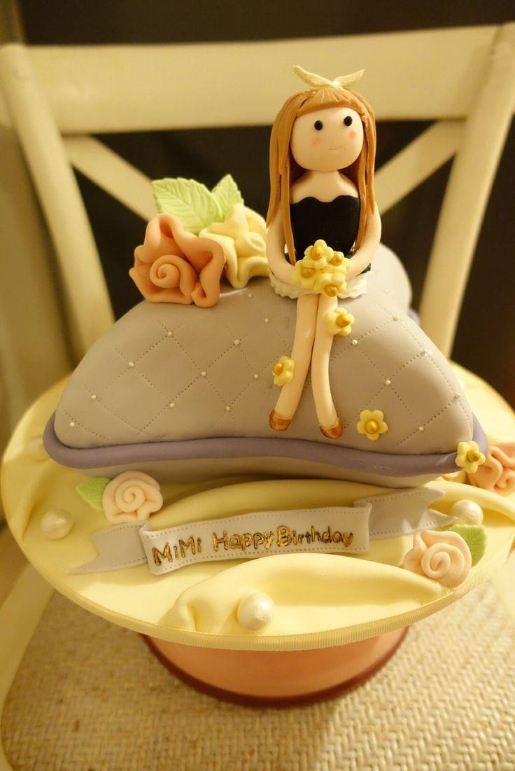 girl on cushion fondant cake