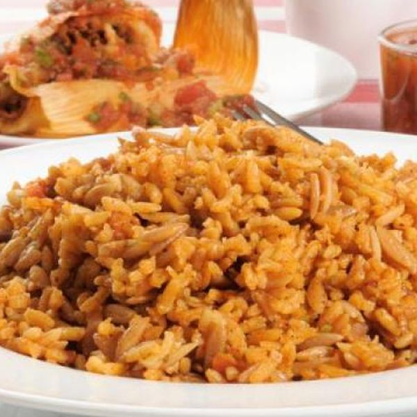 Spanish rice is one of the staples of Mexican meals. I love this stuff, and you will too.. Spanish Rice Recipe from Grandmothers Kitchen.