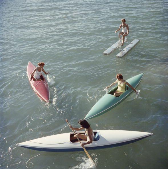 Lake Tahoe Trip Canoeing (© Slim Aarons)Young women canoeing on the Nevada side of Lake Tahoe, 1959.