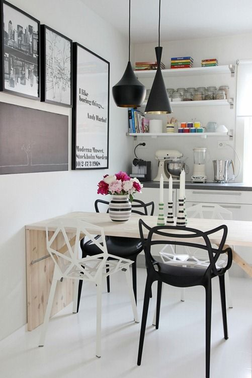 White and blacks, office interior. Tom Dixon pendant lamps, always looking nice. Geometry mixing with timber, giving a little of organics, like Winde Rienstra designs.