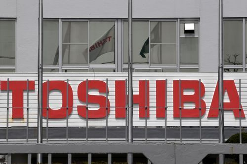 """The Toshiba Corporation logo is seen at the company's R&D Centre in Kawasaki, Kanagawa prefecture March 29, 2017. (Photo: Toshifumi Kitamura, AFP/Getty Images)       Toshiba vice-president and general manager Jeff Barney with the new """"Toshiba Tablet,"""" an iPad-like... http://usa.swengen.com/apple-may-bid-for-toshiba-chips-division/"""