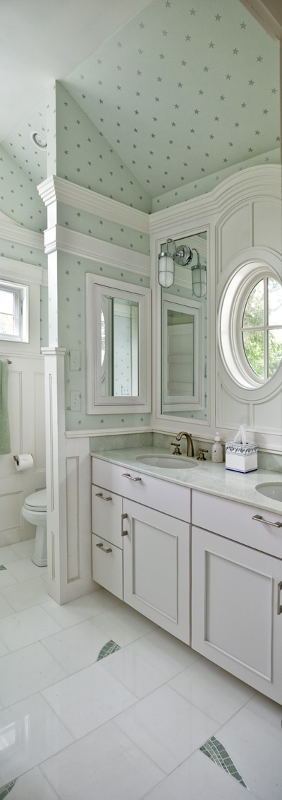 White woodwork, polka dot wall paper and custom tile accents in green? A unique bathroom, to be sure!