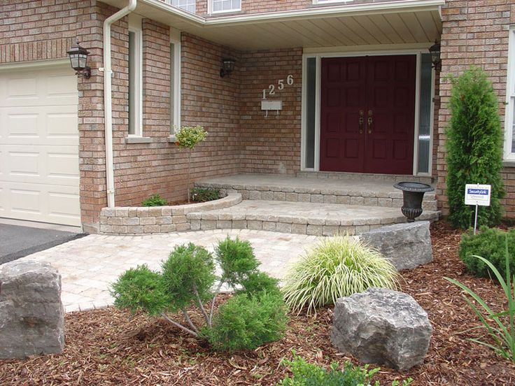 Concrete Porch Covering And A Small Retaining Wall That