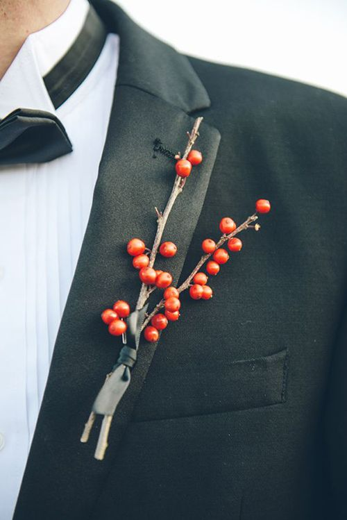 A boutonniere made of red berries   Brides.com