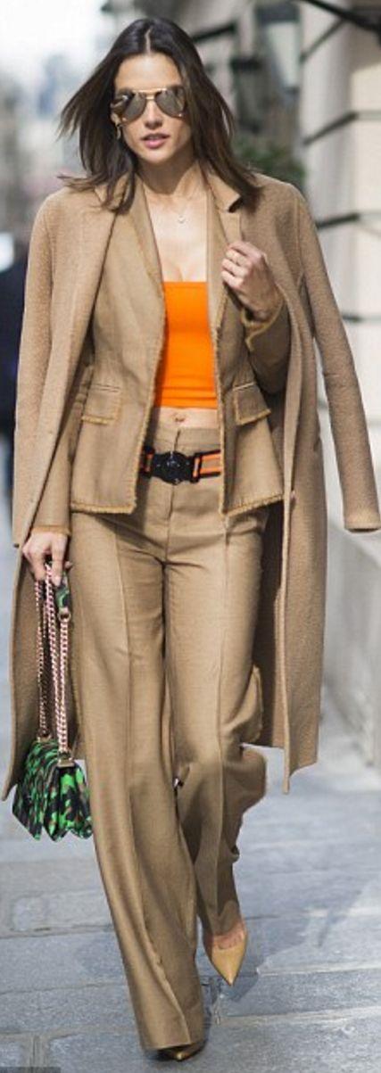 Who made Alessandra Ambrosio's tan coat, brown pants suit, orange belt, cropped top, and green print handbag?