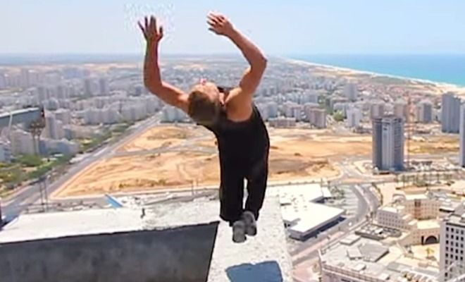 Living Life On The Edge – Watch The Nail Biting Moment When This Guy Does A Backflip On A Ledge 150 Meters Up And Nearly Falls!