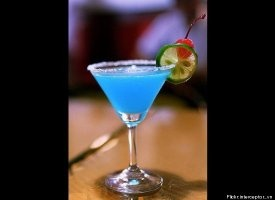 Blue Margarita::1 1/2 parts Milagro silver tequila - 3/4 parts Bols Blue Curaçao - 1 1/2 parts sour mix Directions: 1) Shake all ingredients with ice and strain into an ice-filled, chilled glass. Garnish with an orange wedge.