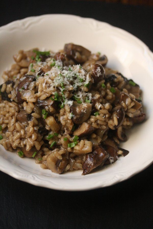 Mushroom risotto is a great gluten-free weeknight vegetarian meal. This healthy version is packed with wild mushrooms and finished with chives.