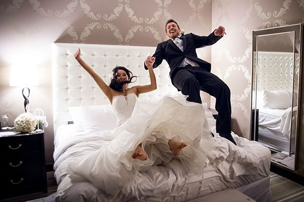 Celebrate your newlywed bliss by jumping on the bed in your hotel room.Related: 25  Ways to Preserve Your Wedding Memories