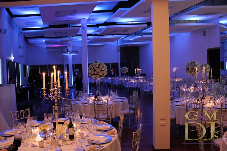 Blue wedding lighting design at Moda Events | G&M DJs | Magnifique Weddings #gmdjs #magnifiqueweddings #weddinglighting #weddingdjbrisbane #modawedding #modaevents @gmdjs @modaeventsvenue