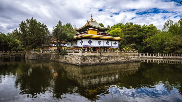Norbulingka Park in Lhasa, Tibet - Small buddhist temple in the pond of Norbulingka park in Lhasa, Tibet.