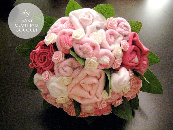 DIY baby clothing bouquet! Excellent idea for shower gift/decorations and something different from your standard diaper cakes. (Another pinner commented. I think this is an interesting idea.)