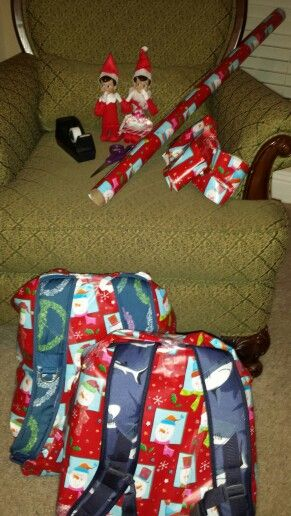 Elf on the shelf.  The elves wrapped the kid's backpacks (straps out so they can wear them to school).