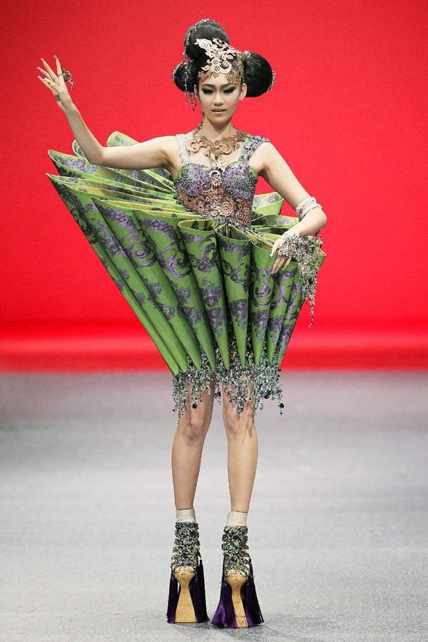 A model showcases an outfit by Chinese fashion designer Guo Pei, on October 16, 2013 in Singapore during the Fide Fashion Week 2013 Asian Couture show.