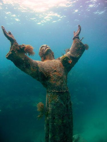 """SOME FACTS ON STATUE...  The original sculpture, """"Il Cristo degli Abissi"""" is in the Mediterranean sea off San Fruttuoso between Camogli and Portofino on the Italian Riviera. It was placed in the water on 22 August 1954 at approximately 17 metres depth, and stands 2.5 metres (8.5 feet) tall."""