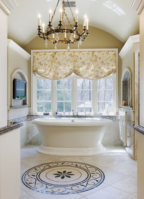 A #mosaic-tile-medallion is in the center of the #bathroom under a #chandelier