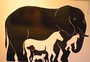 Animal painting illusion. If you look carefully you'll be able to recognize a bunch of animal shadows.
