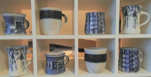 Stoneware mugs, white glaze, blue cobalt