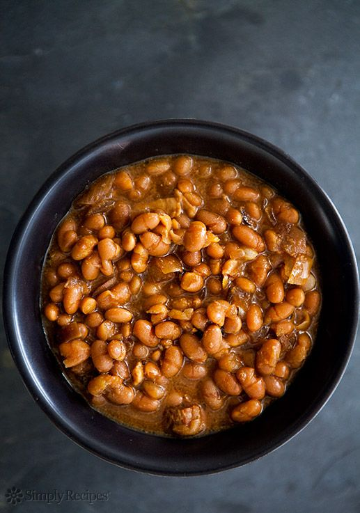 Slow Cooked Boston Baked Beans Recipe on SimplyRecipes.com White beans cooked with salt pork and onions, in a molasses mustard sauce. #crockpot #glutenfree #dinner