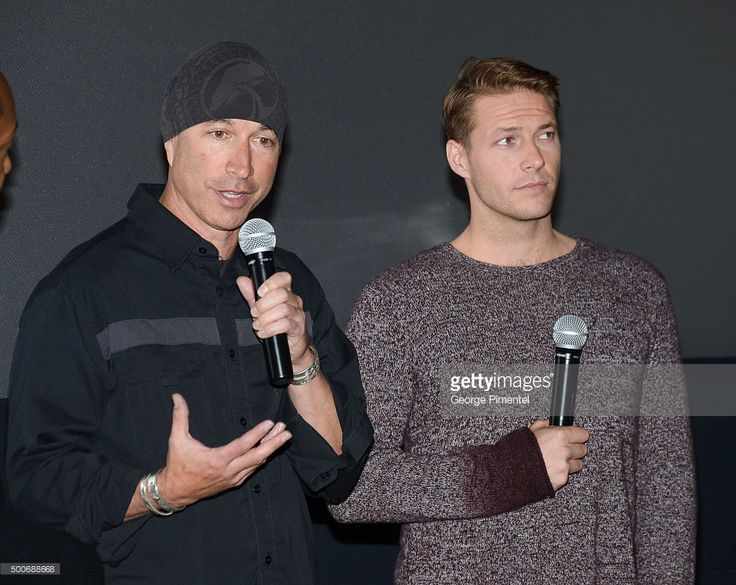 Director Ericson Core and Actor Luke Bracey from the film 'Point Break' surprise Canadian fans at the Toronto advance screening held at Cineplex Odeon Yonge & Dundas Cinemas on December 9, 2015 in Toronto, Canada.