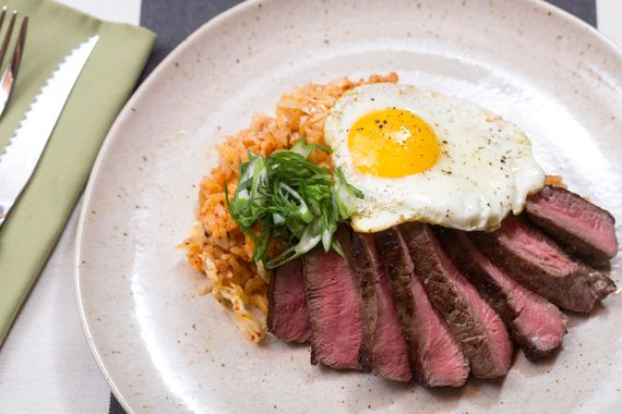 ... steaks and fried eggs Korean-style, with a side of quick kimchi fried