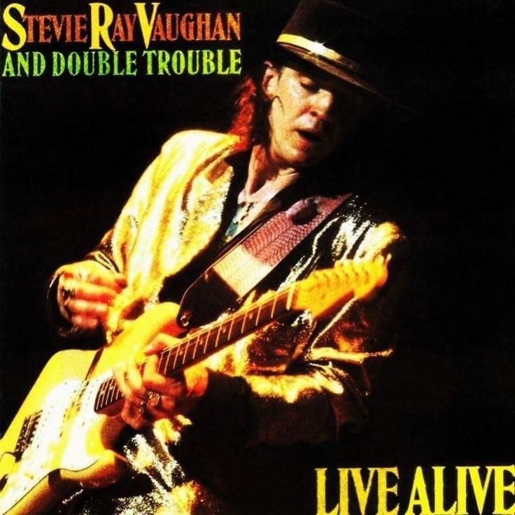 """Released November 15th, 1986 """"Live Alive"""" Is A Live Album By Stevie Ray Vaughan And Double Trouble. The Album Is Compiled From Four Live Performances. The Performances Were Recorded On July 15th, 1985 At The Montreux Jazz Festival , July 17th-18th, 1986 At The Austin Opera House & July 19th, 1986 At The Dallas Starfest."""