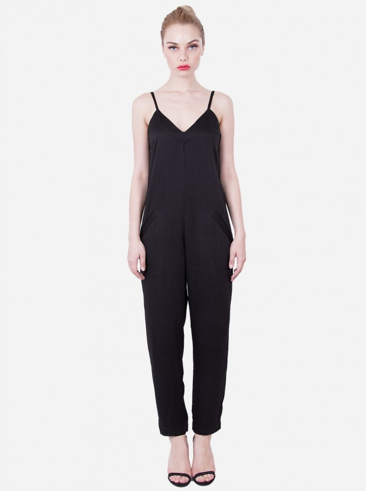 A more classic take on a modern jumpsuit with skinny tank straps, sweetheart-style neckline, and two front pockets. Easy to mix and match with outerwear and accessories to complete your look palette.