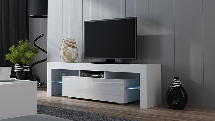 "Modern Room Design With TV Stand MILANO 160 White – Modern LED TV Cabinet – TV Console fit for up to 70″ flat TV´s – Capacity TV stand for modern Living Room (White & White) – Overall dimensions: 17,72""H x 62,99""W x 13,78""D (45 x 160 x 35 cm) Available colors..."