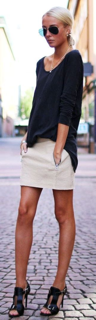 Latest fashion trends: Street style aviator sunglasses, sweater and cream skirt