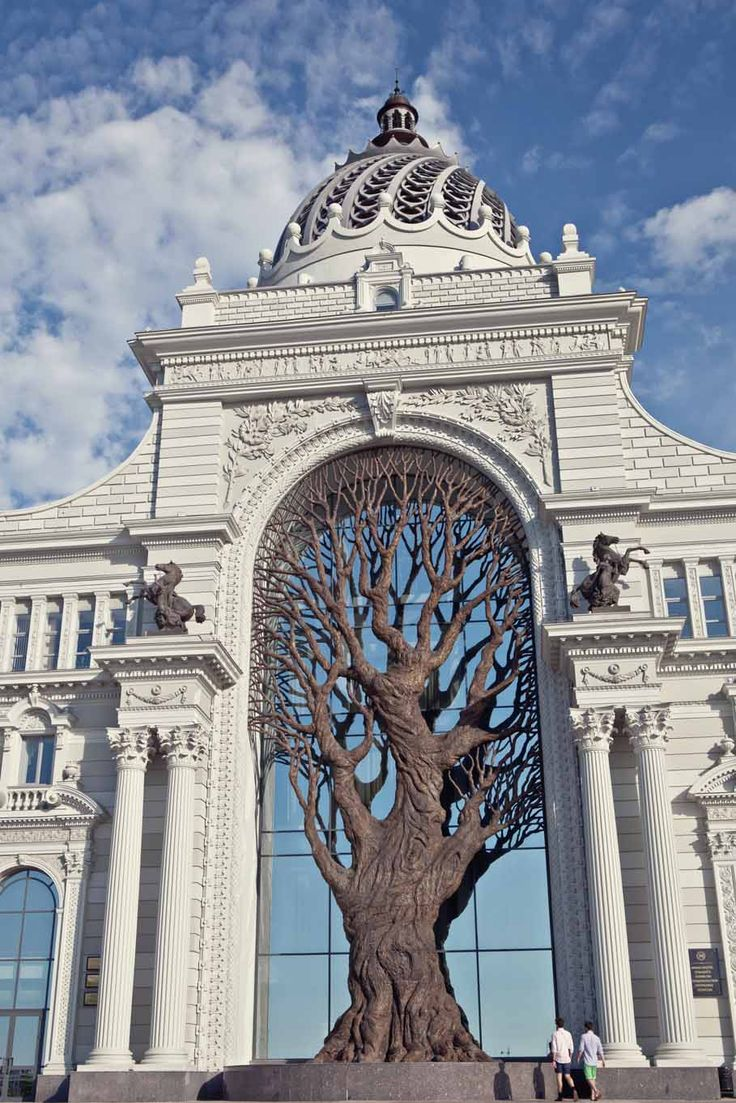 Here's another architectural beauty from Kazan. This is the Ministry of Agriculture Building. What is clearly different about this building is the silhouette of the tree that is formed by a metal sculpture that was built in the center archway to the building. Kazan, Russia