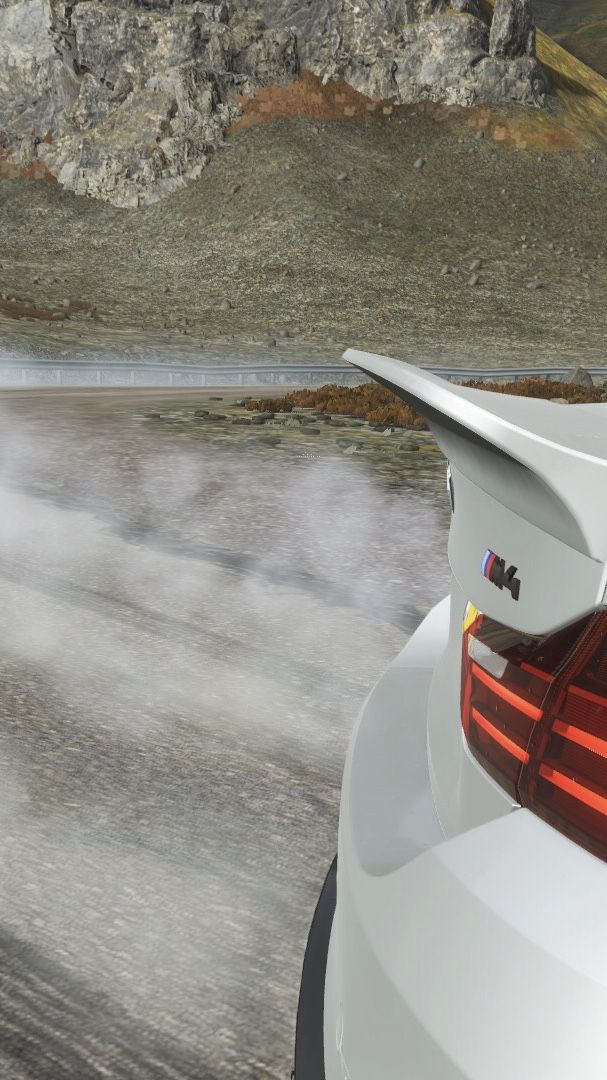 BMW M4 Coupé drifting down Fortune Island's drift Road from